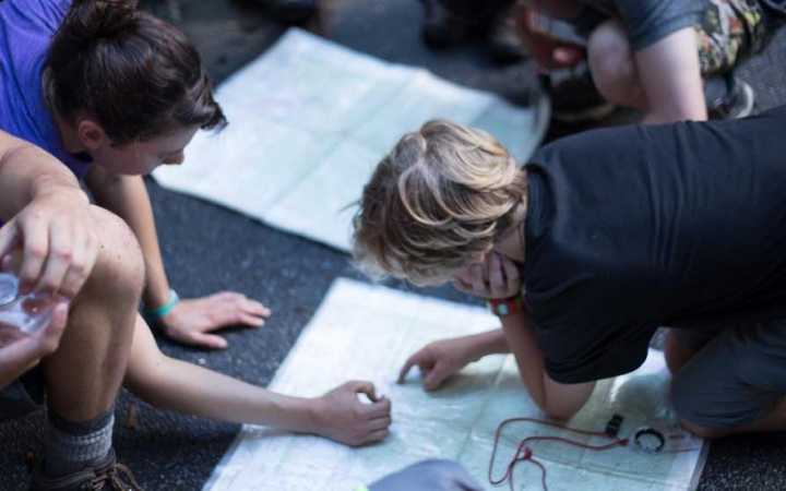high school students learn navigation skills on backpacking course in north carolina