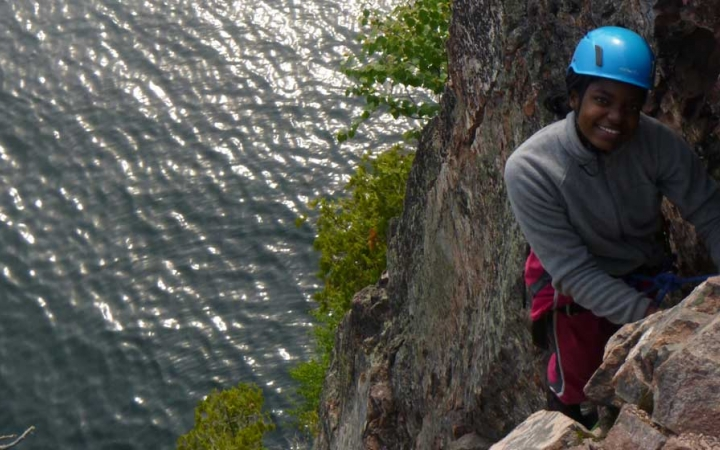 high school students learn rock climbing skills in boundary waters
