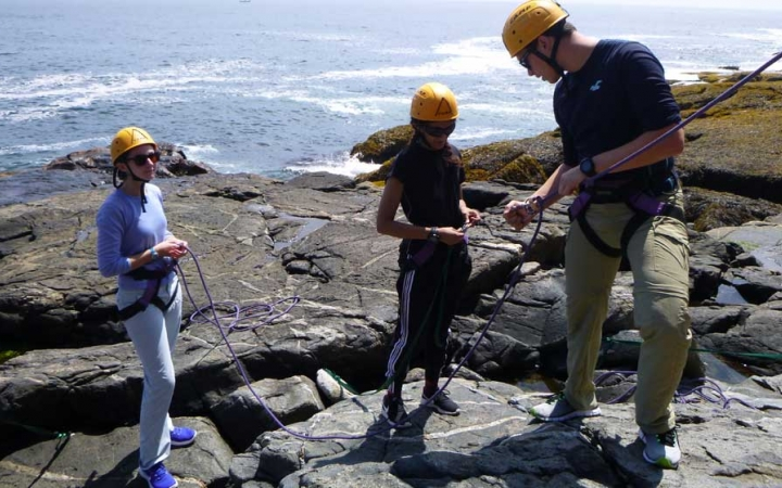 adults unplug during rock climbing class in maine