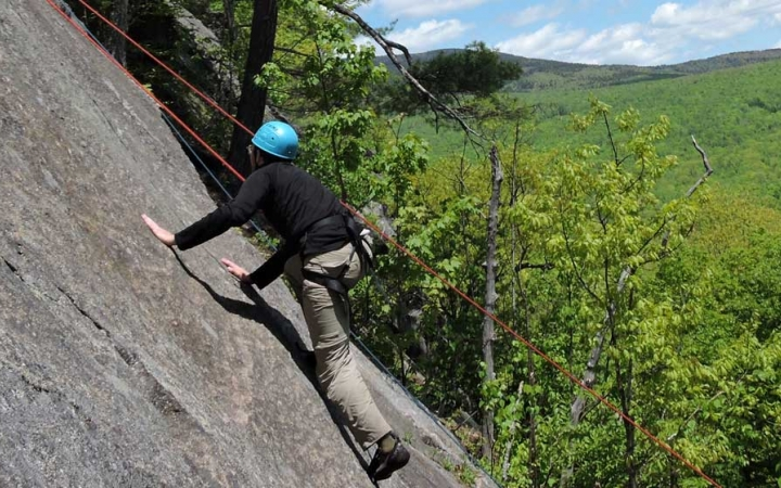 adults learn how to rock climb in maine