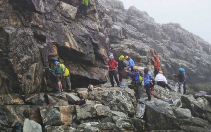 teens face challenges while rock climbing in maine