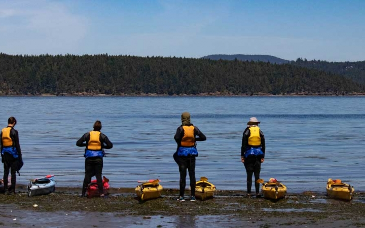 adult kayaking in the pacific northwest
