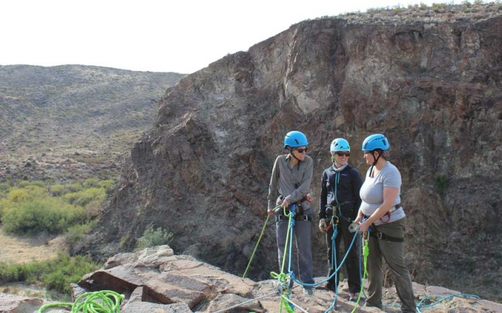adults unplug on rock climbing course